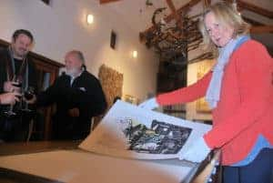 Astrid McLeod placing prints in the limited edition box set. Riaan van Zyl and André van Vuuren in the background.